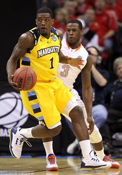 Marquette's Darius Johnson-Odom (1) works for breathing room against Syracuse's Dion Waiters during their third-round NCAA tournament game in Cleveland.
