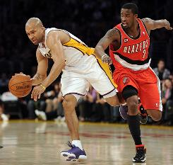 Los Angeles' Derek Fisher keeps away from Wesley Matthews of Portland on Sunday. Fisher 's jumper with 10 seconds left clinched the Lakers' 84-80 win over the Trail Blazers.