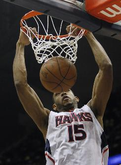Atlanta center Al Horford scores in the second quarter on Sunday. He finished with 18 points and the Hawks beat the Pistons 104-96.