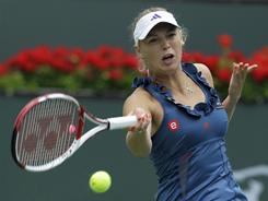 World No. 1 Caroline Wozniacki of Denmark raps a forehand in her victory Sunday against Marion Bartoli of France in the final of the BNP Paribas Open in Indian Wells, Calif.