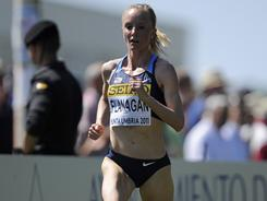 U.S. national champion Shalane Flanagan on her way to a  bronze medal in the 8k at  the 39th IAAF World cross country championships in Punta Umbria, Spain.