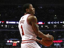 Chicago guard Derrick Rose begins a reverse dunk during the first half on Monday.  He finished with 18 points and the Bulls whomped the Sacramento Kings 132-92.