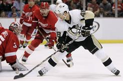 Pittsburgh's Tyler Kennedy scores a second-period goal against the Detroit Red Wings' Jimmy Howard during the Penguins' 5-4 shootout win.