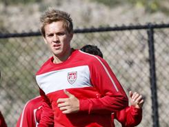 Stuart Holden, seen here practicing with the U.S. men's soccer team in Bridgeview, Ill. in Oct. 2010, will be out of action for six months because of a knee injury.