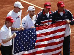 Captain Jim Courier, from left, John Isner, Andy Roddick, Bob Bryan and Mike Bryan got past Chile on March 6 in a first-round Davis Cup match. It was Courier's first appearance as Davis Cup captain.