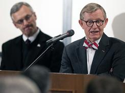Ohio State president E. Gordon Gee, right, takes questions while football coach Jim Tressel looks on during a press conference announcing Tressel's suspension