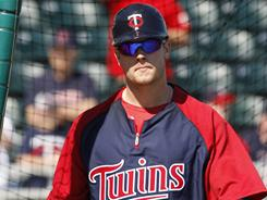 Justin Morneau is trying to come back from a concussion he suffered July 7. He has no hits in 10 at-bats this spring and the Twins aren't sure if he'll play opening day.