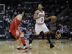 The Bulls' Derrick Rose, right, notched a double-double with 30 points and 10 assists in Chicago's blowout win against the Hawks on Tuesday night.