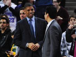 """Sacramento mayor Kevin Johnson, left, seen here at a Kings game on Feb. 28, wrote on his website Tuesday that this """"will likely be the Kings' final weeks in Sacramento after 26 years."""""""