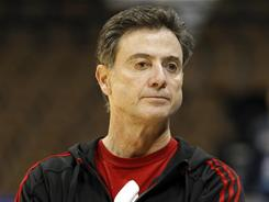 Louisville head coach Rick Pitino, watching his team practice before the NCAA tournament March 16, said he won't defend the Big East when he appears on ESPN.