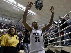 Connecticut's Maya Moore waves to fans as she exits the Gampel Pavilion court for the last time as a player after the Huskies defeated Purdue 64-40.