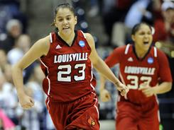 Louisville's Shoni Schimmel (23) celebrates after hitting a three-pointer against Xavier during their second round matchup. The Cardinals upset the Musketeers 85-75.