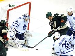 Maple Leafs goalie Jamie Reimer denies Wild center Kyle Brodziak, right, on a rebound shot in the third period en route to his third career shutout. Toronto, a 3-0 winner Tuesday, is chasing a playoff berth in the Eastern Conference.