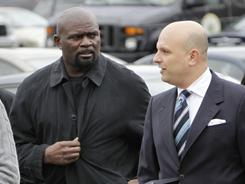 Pro Football Hall of Famer Lawrence Taylor, left, arrives at a courthouse outside New York City for sentencing in a sexual misconduct case. An attorney accompanied the former New York Giants star.