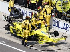 Sarah Fisher, climbing out of her car at the 2010 Indianapolis 500, has solid funding from her sponsor Dollar General, but not enough to run an entire IndyCar season.