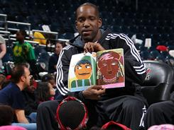 Milwaukee's Michael Redd, seen here reading to children during a March 3 event, will see his first action in 14 months this week.