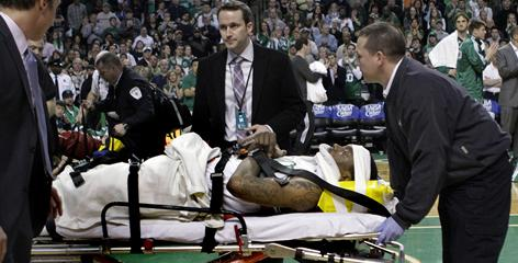 Marquis Daniels, then playing for the Celtics, is taken off the court on a stretcher Feb. 6. He was later traded to the Kings, never reported and will have season-ending surgery next week.