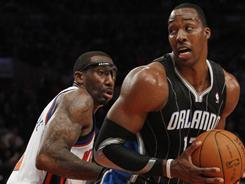 Orlando's Dwight Howard, right, defended by fellow Eastern Conference All-Star Amar'e Stoudemire, scored 33 points on 11-for-15 shooting in the Magic's win over the Knicks.