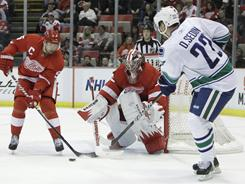 Canucks left wing Daniel Sedin, right, scored both goals in Wednesday night's game against the Red Wings.