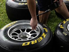 A mechanic checks the pressures in a new set of Pirelli tires Thursday ahead of the Australian Grand Prix in Melbourne. The season-opening Formula One race, scheduled for Sunday, sees Pirelli as the new tire manufacturer.