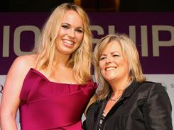 WTA CEO Stacey Allaster, right, with world No. 1 Caroline Wozniacki, says the WTA has emerged from an extremely difficult economic period on firm financial footing.