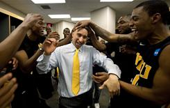 VCU coach Shaka Smart and players celebrate their 72-71 overtime victory over Florida State in the NCAA tournament Southwest Regional semifinal in San Antonio.