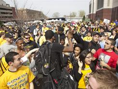 Fans cheer as Virginia Commonwealth University's basketball team leaves for San Antonio. The Rams, in their first Sweet 16, play Florida State on Friday night at the Alamodome.