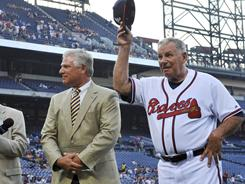 Braves general manager Frank Wren, left, with former manager Bobby Cox during a pre-game presentation last season.
