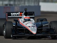 Team Penske's Will Power accelerates off turn 12 on the St. Petersburg, Fla., street course Friday. Power turned the fastest lap on the first day of practice for the season-opening Honda Grand Prix of St. Petersburg.