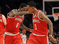 Brandon Jennings (3) and Larry Sanders (8) celebrate Jennings' fourth-quarter three-pointer that helped put away the Bucks' win over the Knicks.