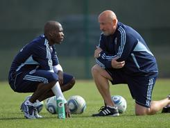 Chad Ochocinco, left, speaks with Sporting Kansas City assistant coach Zoran Savic during a break in his four-day trial with the MLS team.