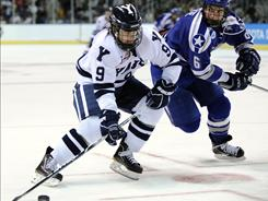 Yale's Brian O'Neill (9) skates past Air Force's Adam McKenzie during the second period of an East Regional semifinal in the NCAA hockey tournament.