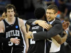 Butler guard Shawn Vanzant hugs head coach Brad Stevens after they defeated Florida in the NCAA Tournament Southeast Regional final in New Orleans.
