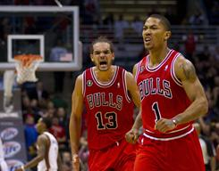 Chicago Bulls guard Derrick Rose (1) and center Joakim Noah (13) react after a fourth-quarter basket against the Milwaukee Bucks at the Bradley Center. The Bulls won 95-87.