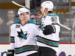 Ryane Clowe (29) scored once and Logan Couture (39) twice in the Sharks' win over the Coyotes.