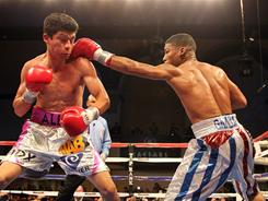 Yuriorkis Gamboa punches Jorge Solis during their IBF WBA World Featherweight title bout on Saturday night. Gamboa won in a fourth-round knockout.