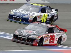Kevin Harvick (29) passes Jimmie Johnson (48) on the last lap and beats him to the finish line to win the Auto Club 400 Sunday in Fontana, Calif.