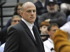 In this Feb. 12, 2010, file photo, Penn State head wrestling coach Cael Sanderson stands during a meet against Michigan State in State College, Pa.