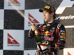 Sebastian Vettel of celebrates with champagne after winning the Australian Grand Prix, the first race of the 2011 Formula One season.