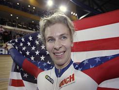 Sarah Hammer became the first American woman to earn three medals at the cycling world championship.