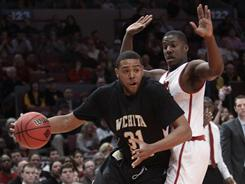 J.T. Durley, left, scored 12 points as Wichita State used a balanced attack to defeat Alabama 66-57 for the NIT championship at Madison Square Garden.