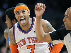 Carmelo Anthony, seen here celebrating after hitting a three-pointer during in the third quarter, led all scorers with 39 points as the Knicks beat the Magic 113-106 in overtime.