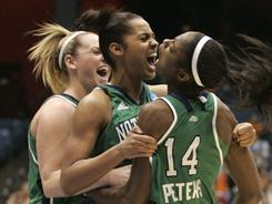 From left, Notre Dame players Brittany Mallory, Skylar Diggins and Devereaux Peters celebrate late during their 73-59 victory vs. Tennessee to win the Dayton Regional and advance to the Final Four.
