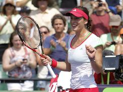 Andrea Petkovic of Germany dances after defeating Caroline Wozniacki of Denmark 7-5, 3-6, 6-3 at the Sony Ericsson Open on Monday in Key Biscayne, Fla.