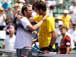 Mardy Fish of the USA is congratulated by Juan Martin del Potro of Argentina after Fish won in straight sets on Tuesday at the Sony Ericsson Open in Key Biscayne, Fla.