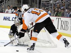 The Flyers' Scott Hartnell scores one of his team's five goals in its 5-2 win against the Penguins on Tuesday night.