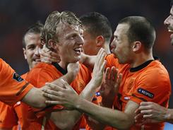 Dirk Kuyt, left, scored twice in the final 12 minutes to lift the Netherlands past Hungary.