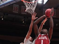 JaMychal Green (1), seen here putting up a shot as Colorado's Andre Roberson (21) defends, scored 22 points in Alabama's NIT semifinal win. The Crimson Tide will play Wichita State in the final.