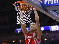 Rockets shooting guard Kevin Martin throws down two of his team-high 20 points in Houston's win over the Nets in New Jersey on Tuesday.