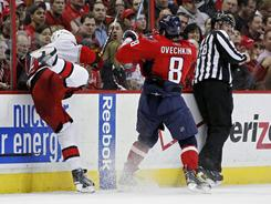 Capitals left wing Alex Ovechkin, seen checking Tuomo Ruutu, returned to action Tuesday. The Capitals  lost 3-2 in a shootout.